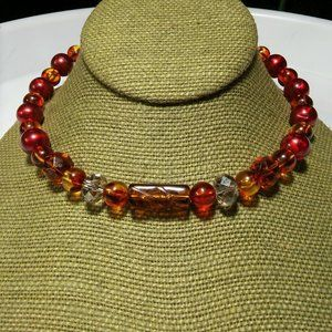 Women`s fall red orange beaded wire necklace. 15